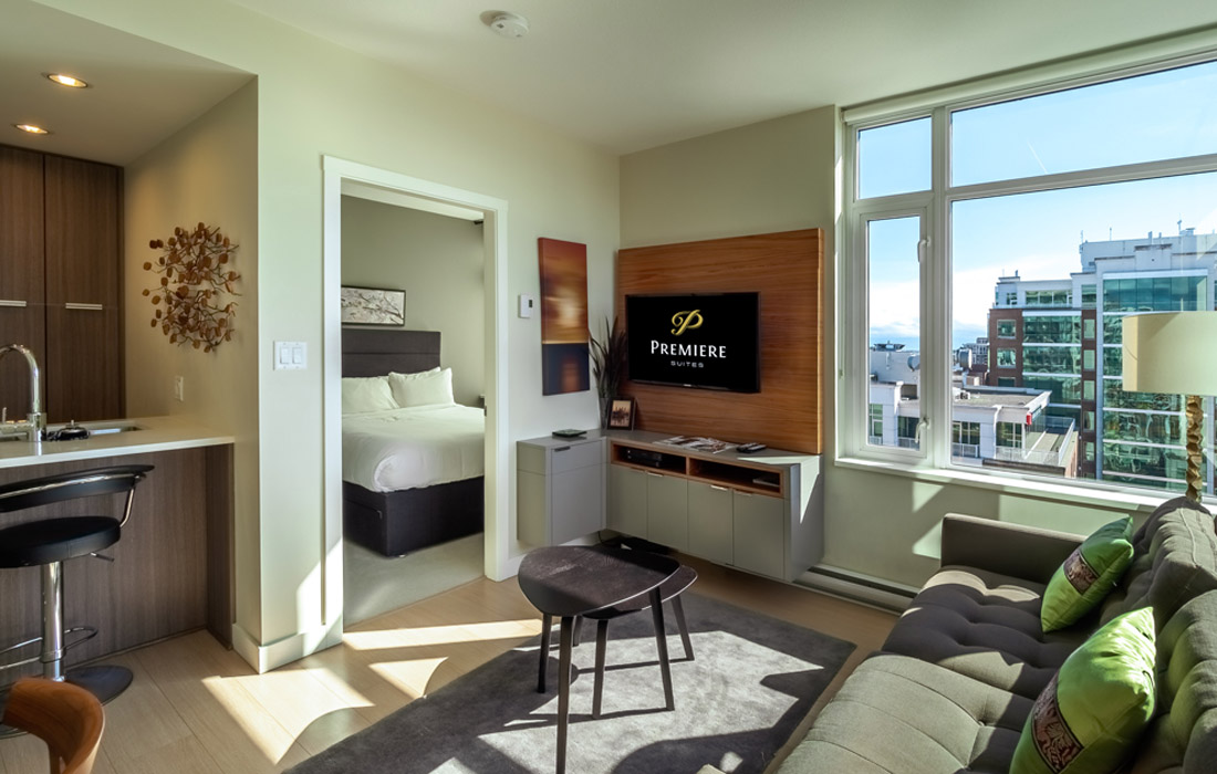 Executive condo flatscreen TV and queen bedroom