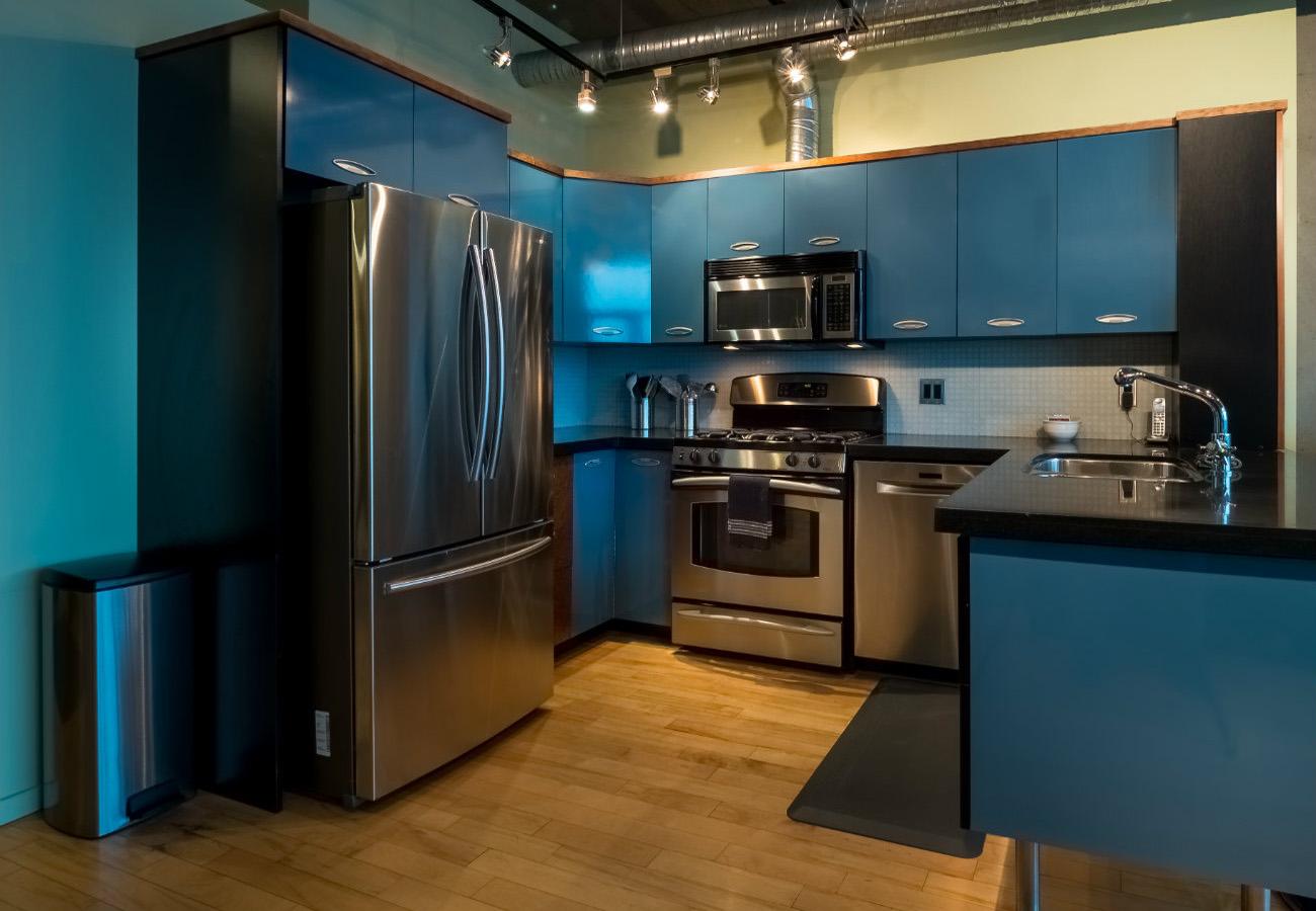 Kitchen, stainless appliances, penthouse condo