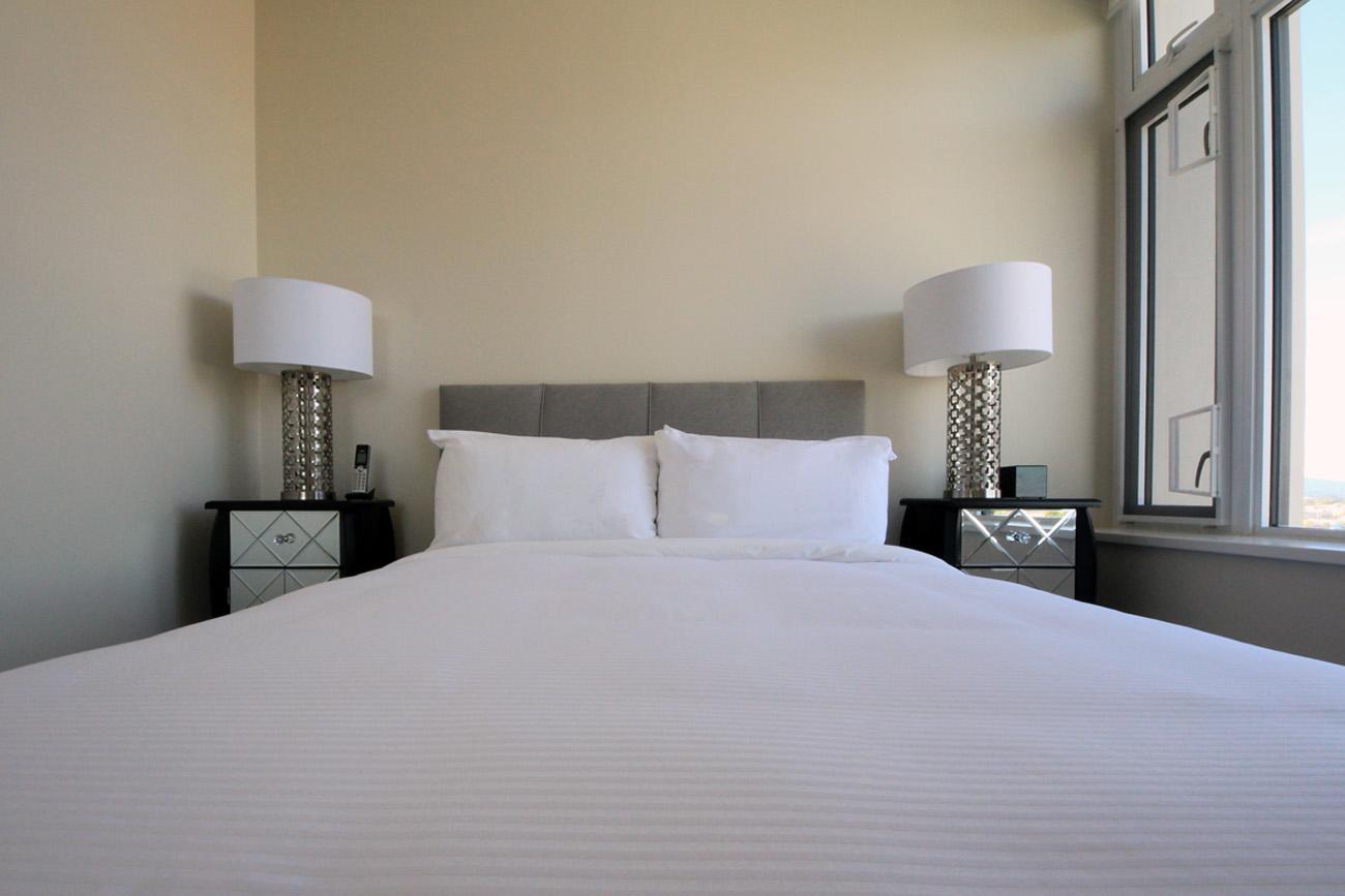 Era condo Victoria master bedroom queen bed