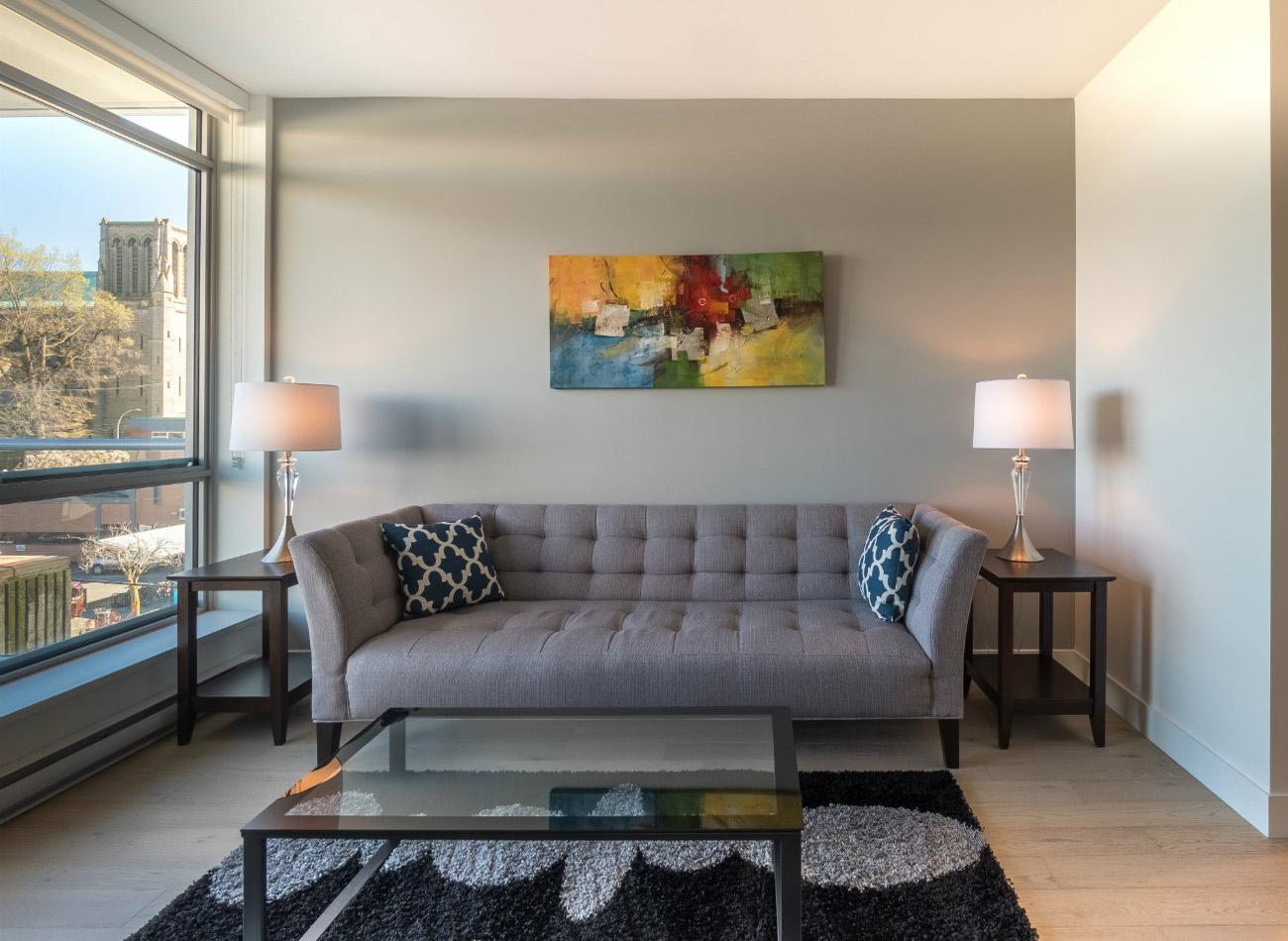 Escher condo furnished living room Victoria