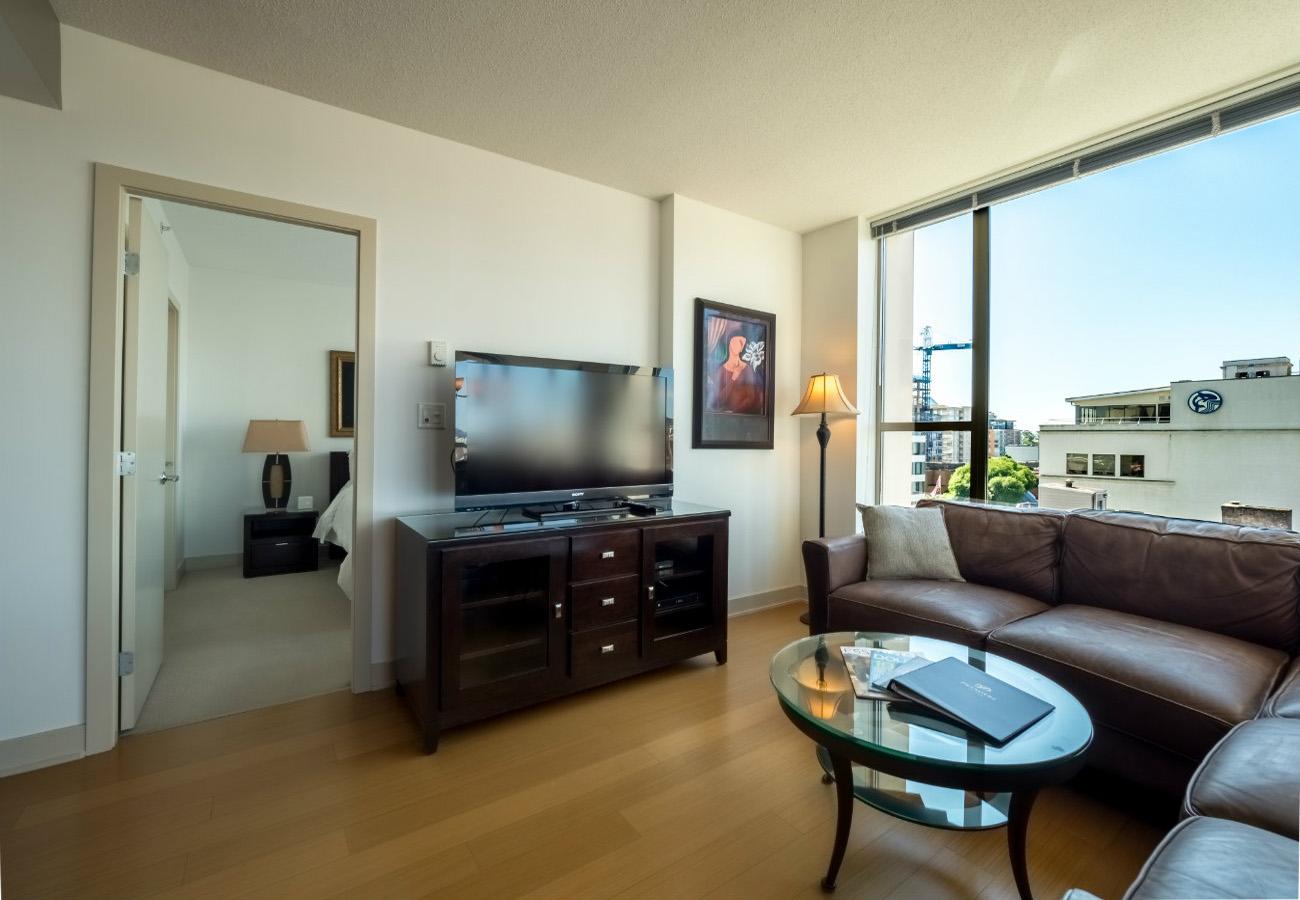 Living room flat screen TV executive rental at the Juliet condo Victoria