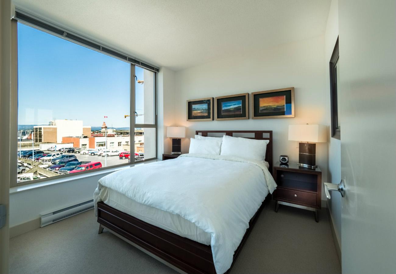 Bedroom with queen bed executive rental at the Juliet condo Victoria