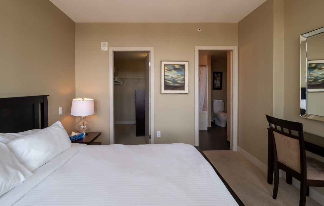 Victoria Condo bedroom with walk-in closet and shared ensuite