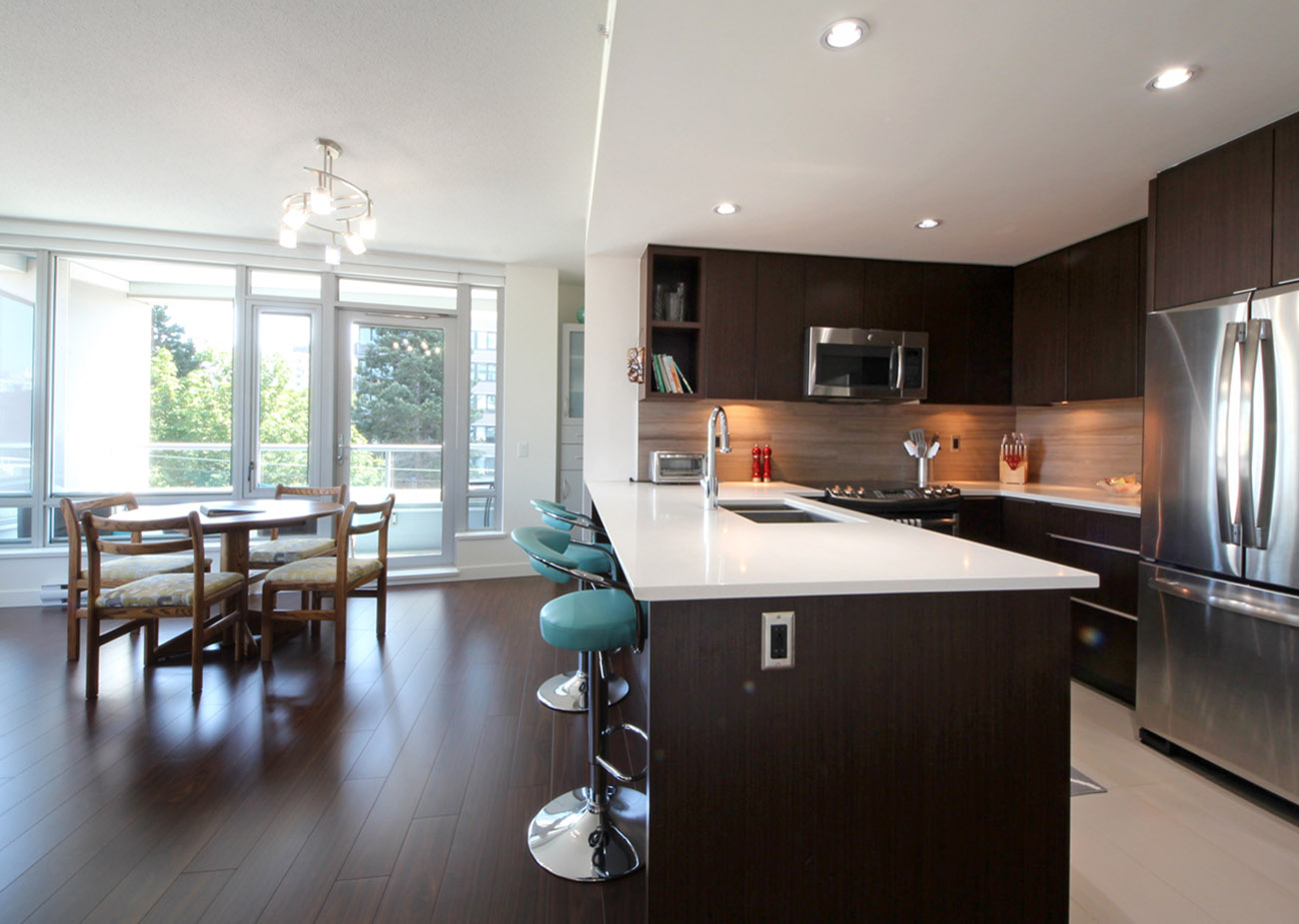 Kitchen and dining area with seating for four