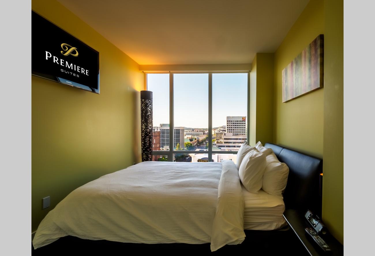 luxury condo suite bedroom with flatscreen TV