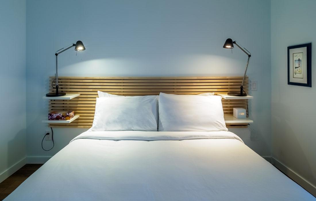 Bedroom queen bed Union boutique condo victoria bc