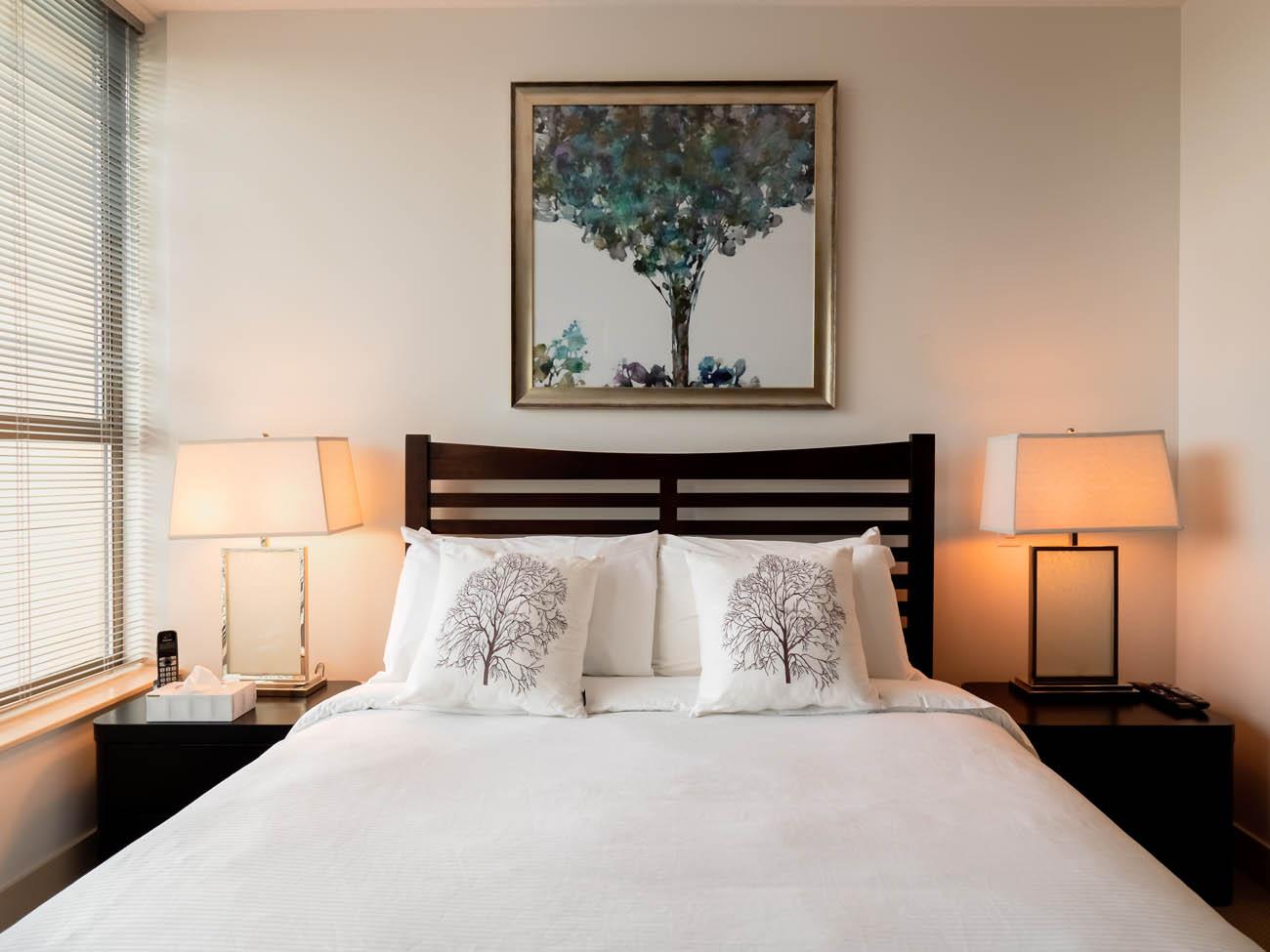 downtown suite bedroom queen bed