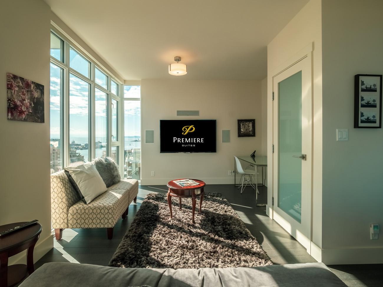Premiere Suites Victoria rental condo flatscreen TV, furnished living room, views