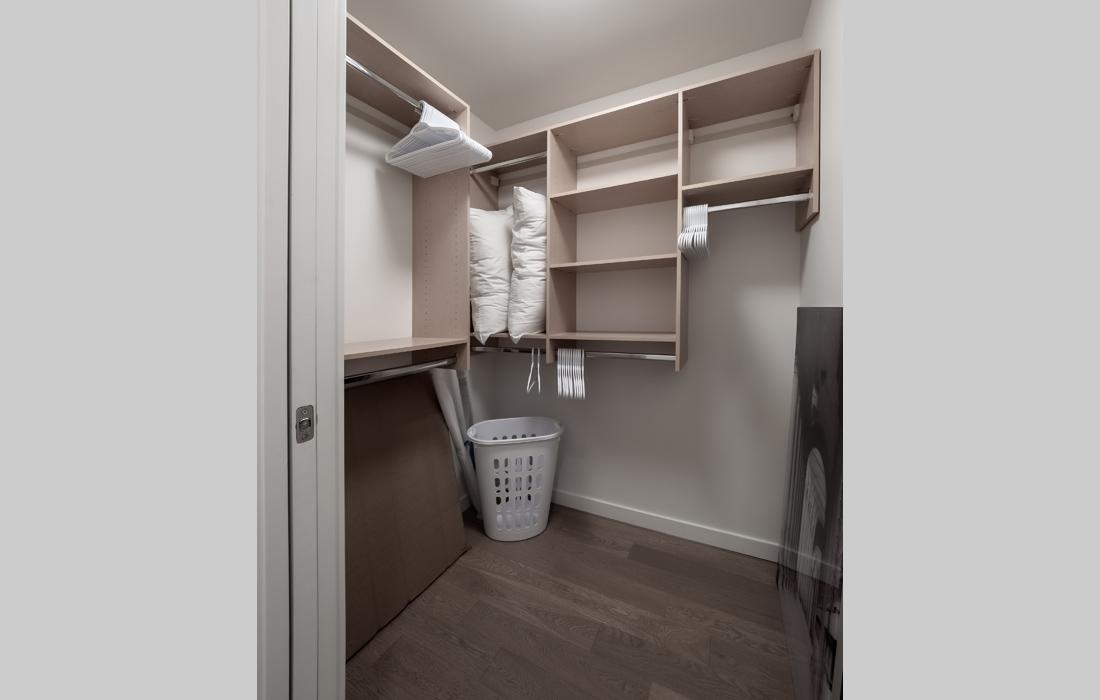 Black and White condo master walk-in closet