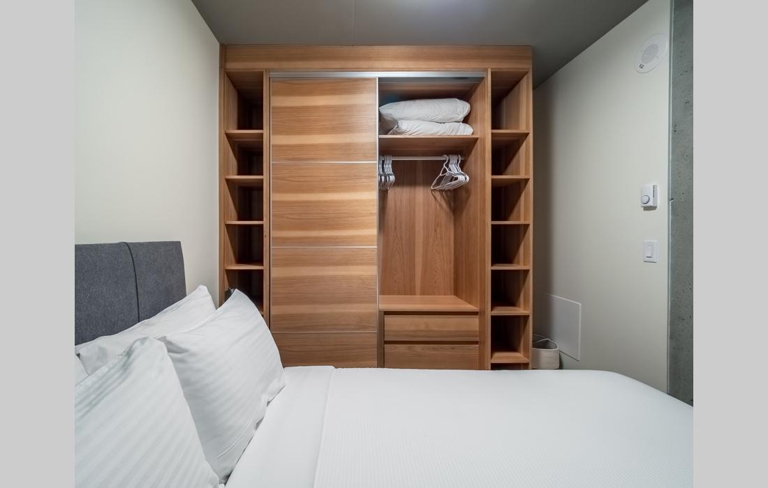 Bedroom in open concept condo