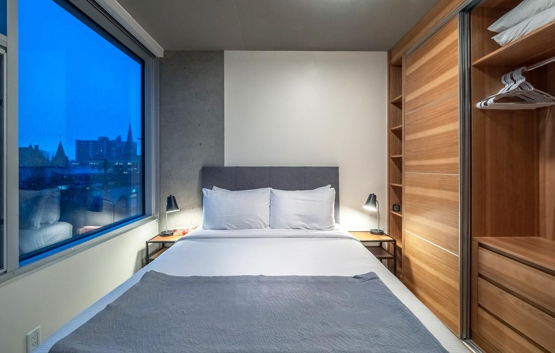 Open concept condo bedroom